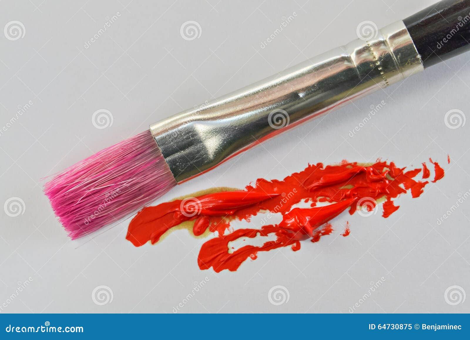 Pennello e colore a olio rosso