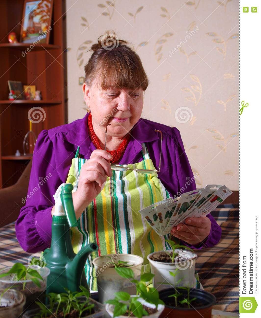 Pensioner chooses the seed for planting