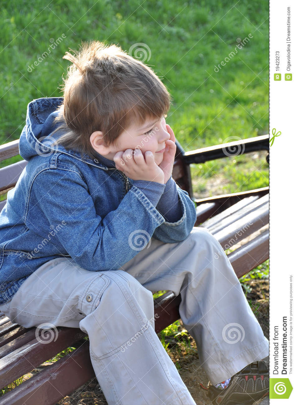 Pensive Boy Sitting On A Park Bench Stock Photos Image