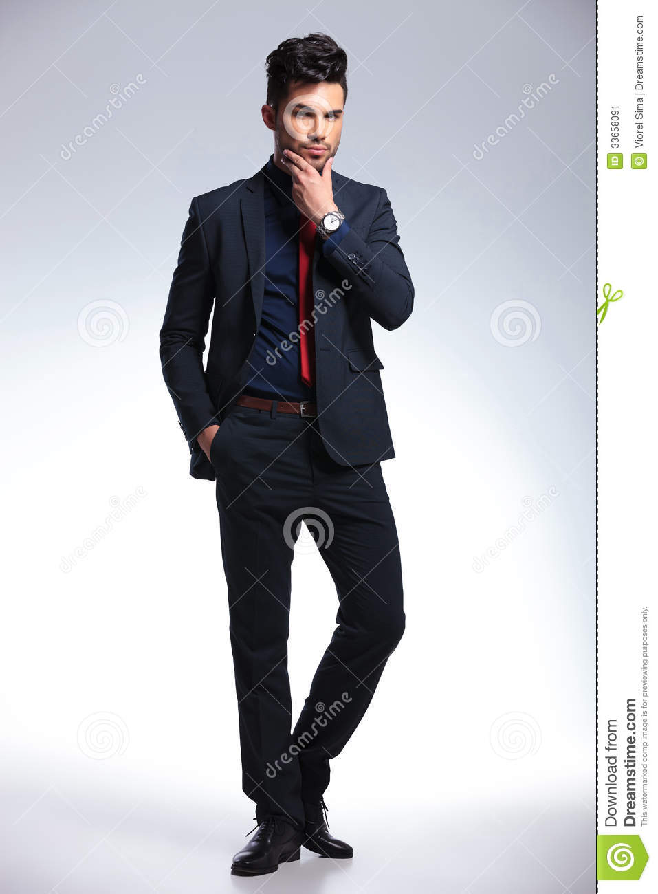 Pensive Young Fashion Man Looks At You Stock Image
