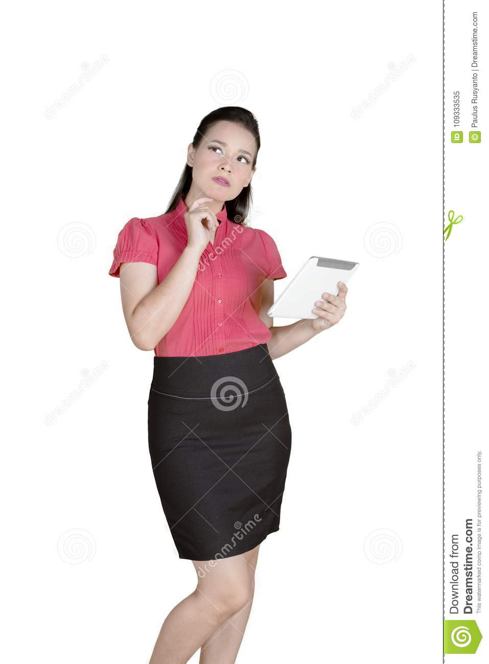Pensive businesswoman working with a tablet on studio