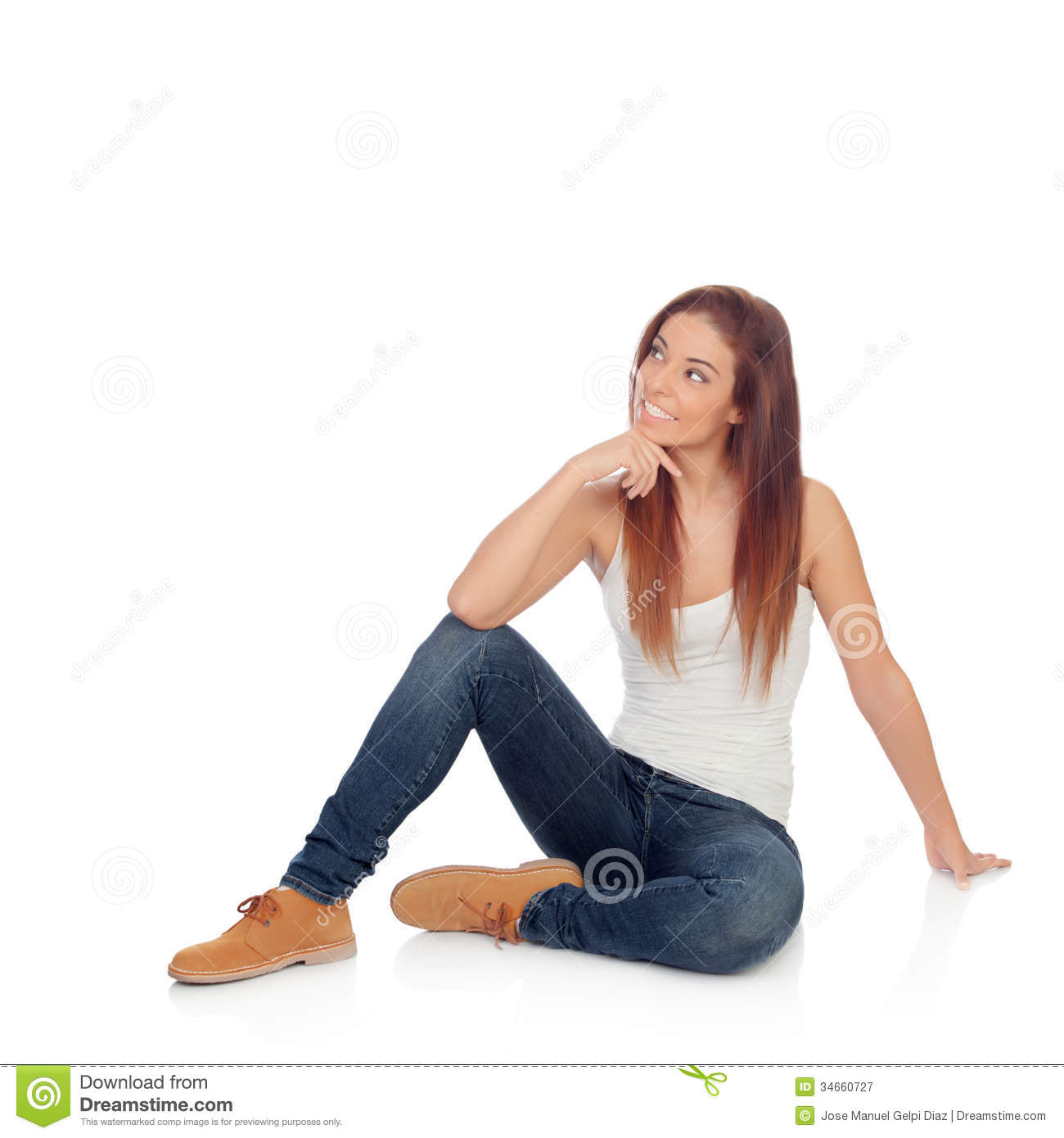 Pensive casual young woman sitting on the floor isolated on a white ...