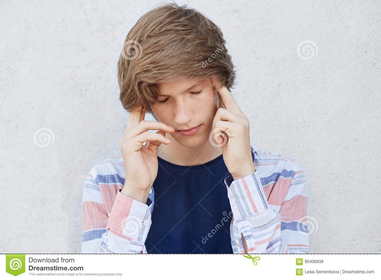 Pensive Concentrated Teenage Boy With Stylish Haircut