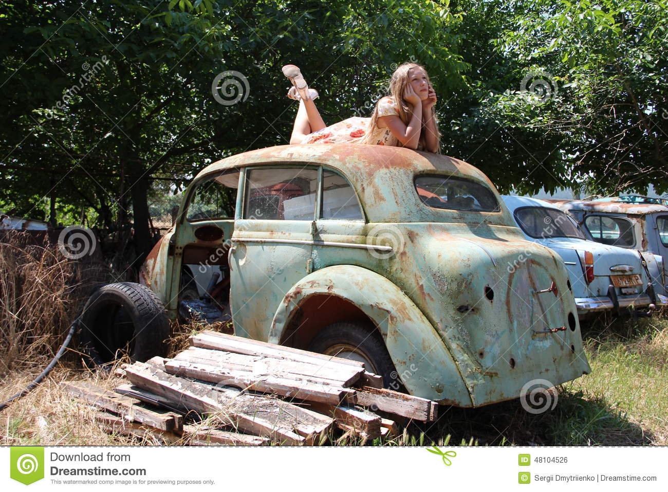pensive country girl from an old broken car stock photo image of