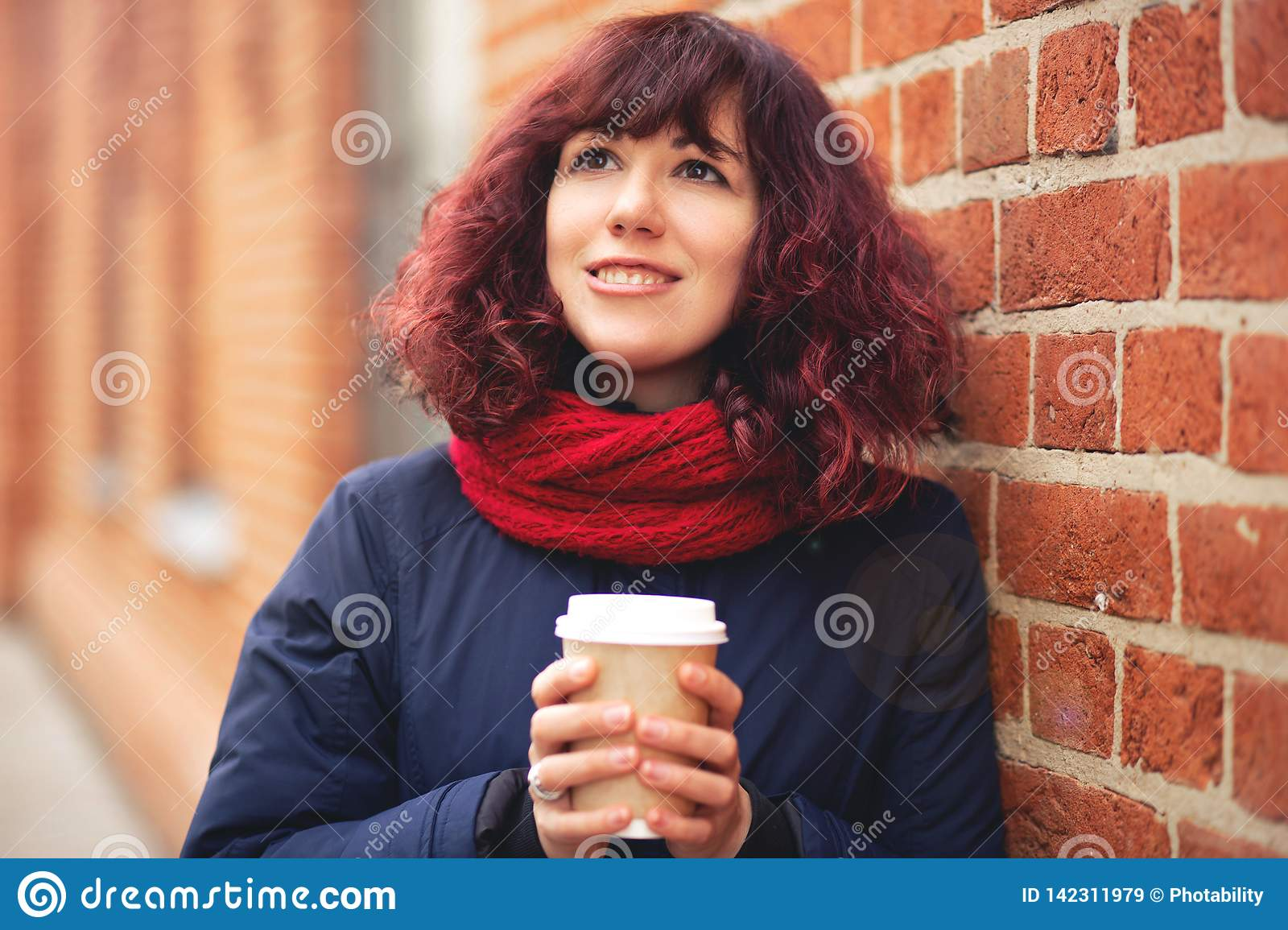 Girl with a glass of coffee in hand
