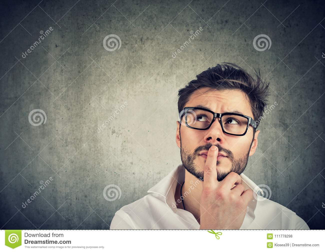 Pensive man trying to make decision