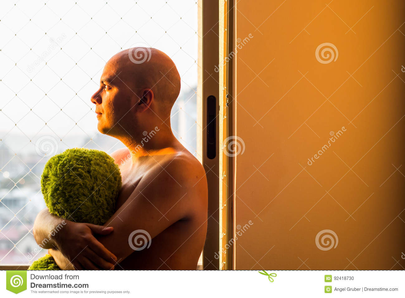 Pensive man at the window