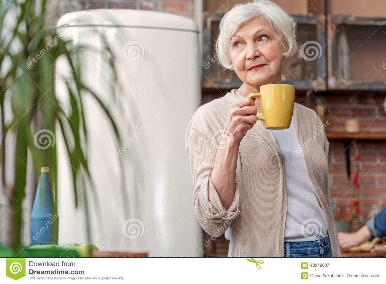 pensive mature lady drinking hot beverage stock image - image of
