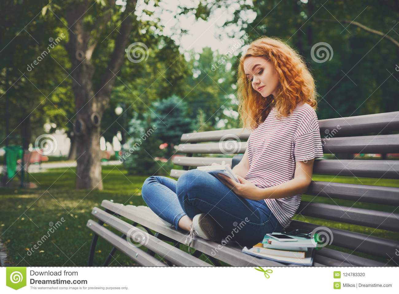 Redhead on bench speaking, you