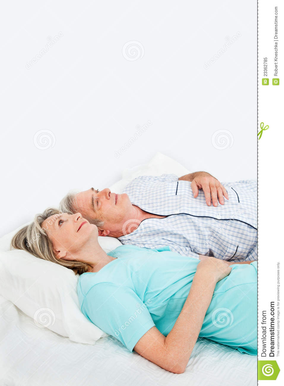 pensive senior couple in bed royalty free stock photo image 23362785. Black Bedroom Furniture Sets. Home Design Ideas