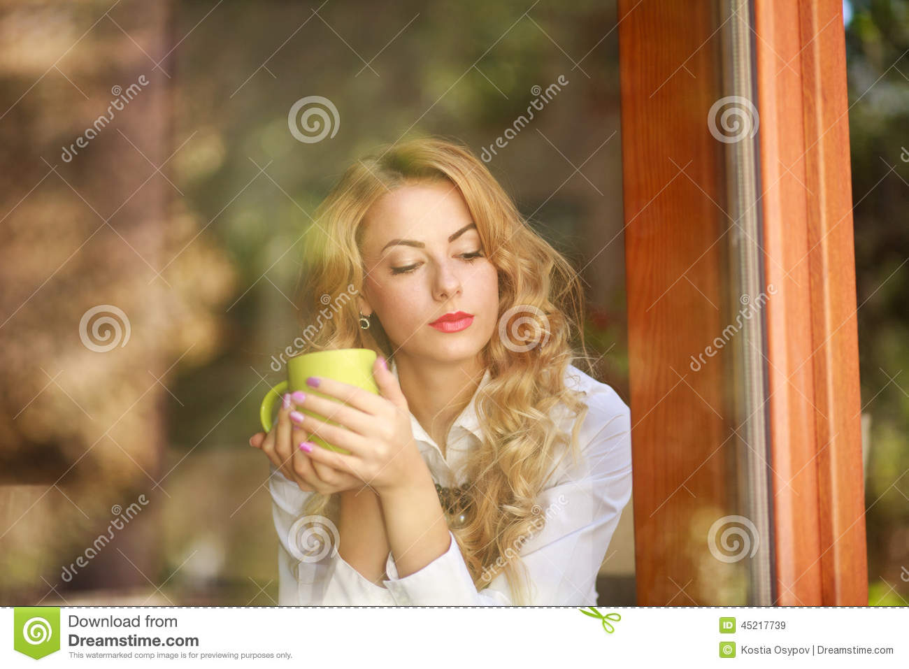 Pensive Woman Drinking Coffee At Home Looking Out The