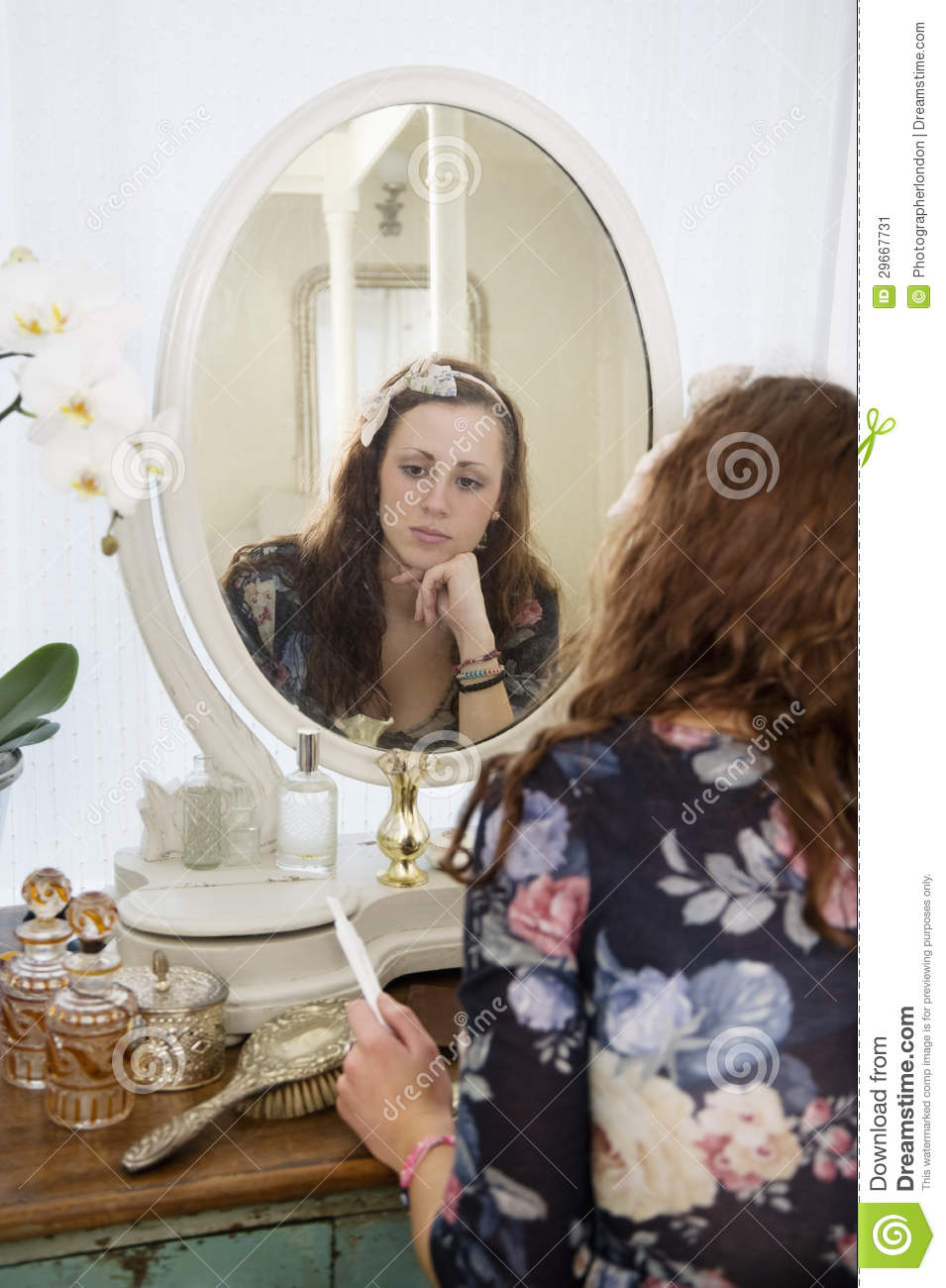 Pensive woman sitting at dressing table stock image for Womens dressing table