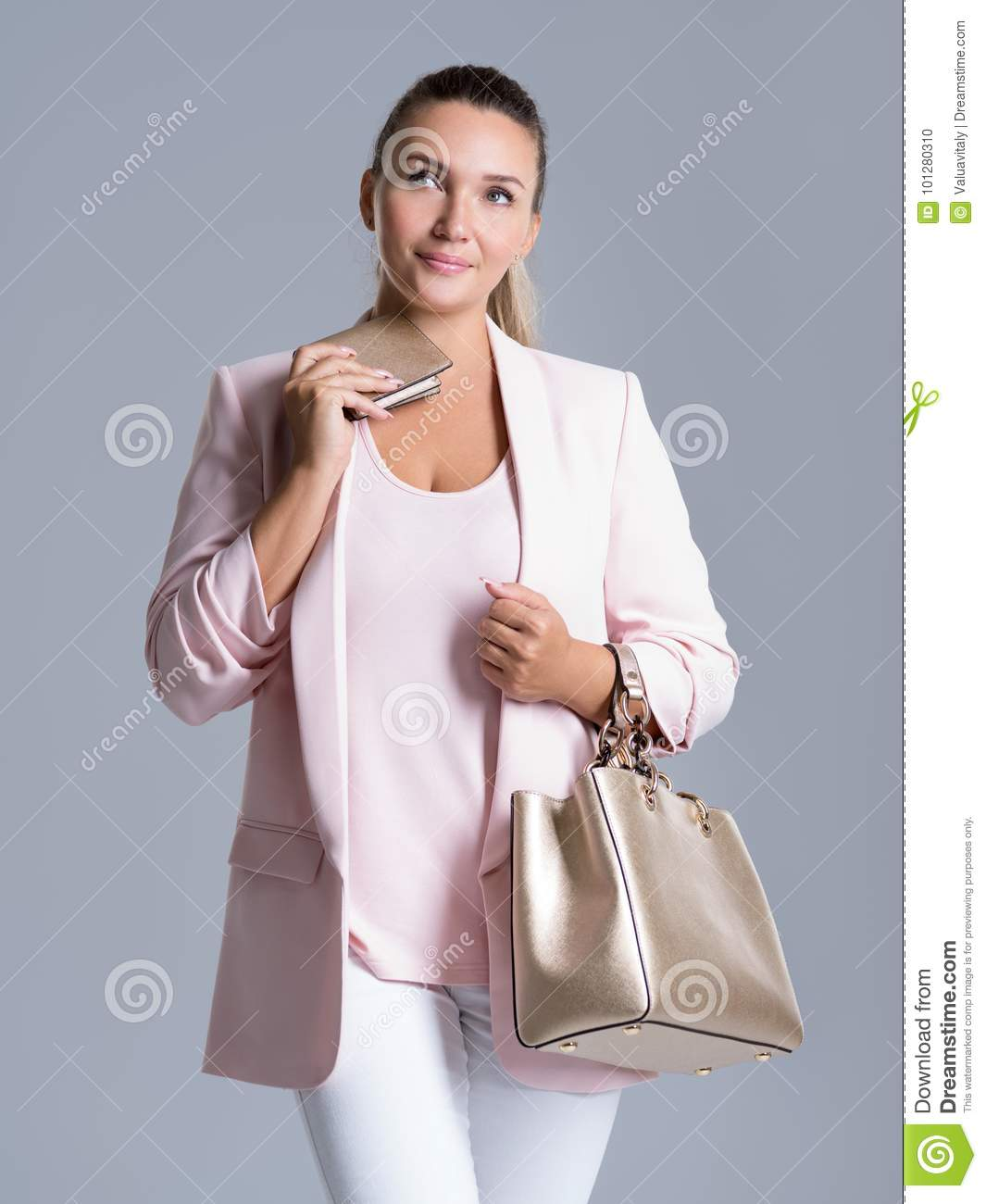 Pensive woman with wallet in hand and a handbag