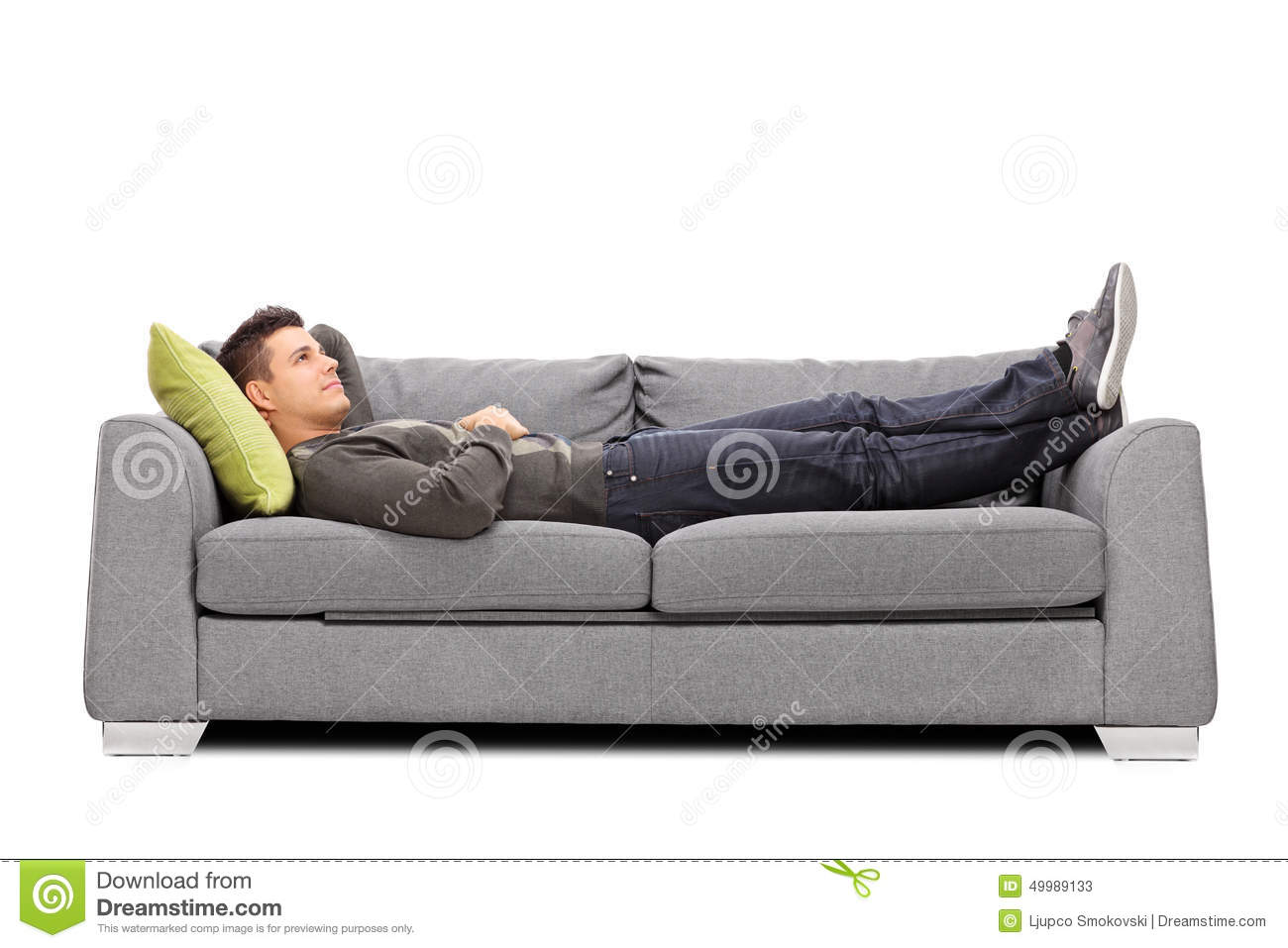 Pensive Young Guy Laying On A Sofa Stock Photo - Image: 49989133