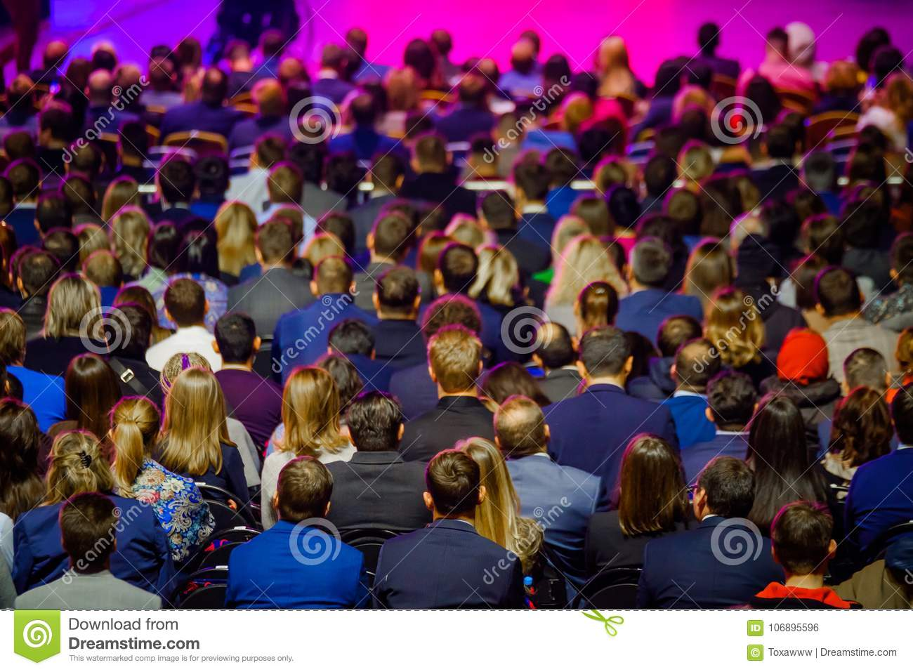 People attend business conference in congress hall