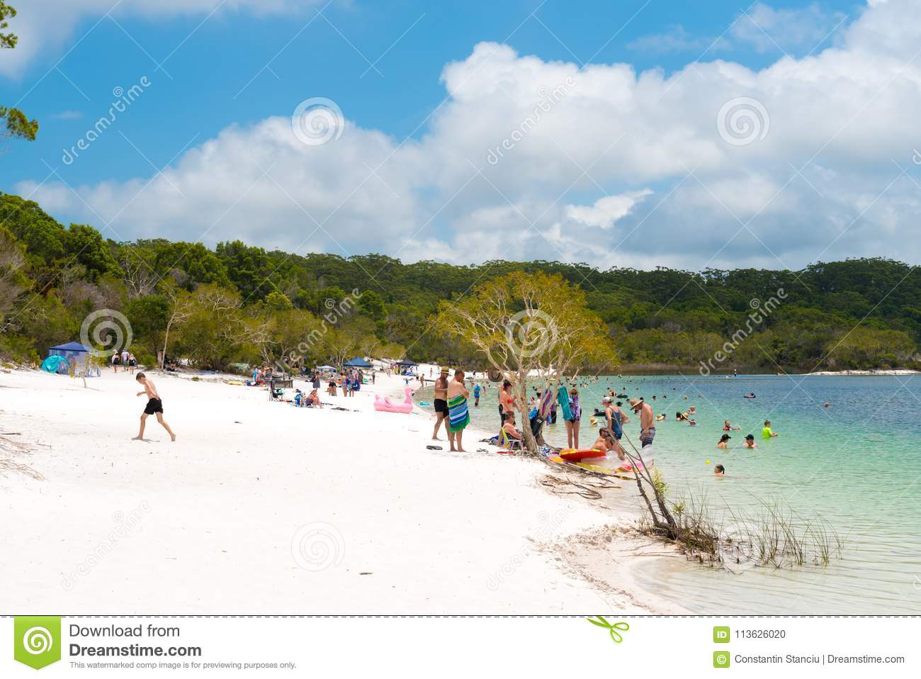 People at the beach at Lake McKenzie, one of the popular freshwater lake at Fraser Island, Australia