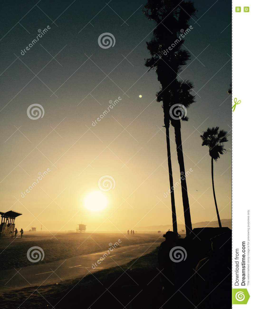 People on the beach at sunset in southern California