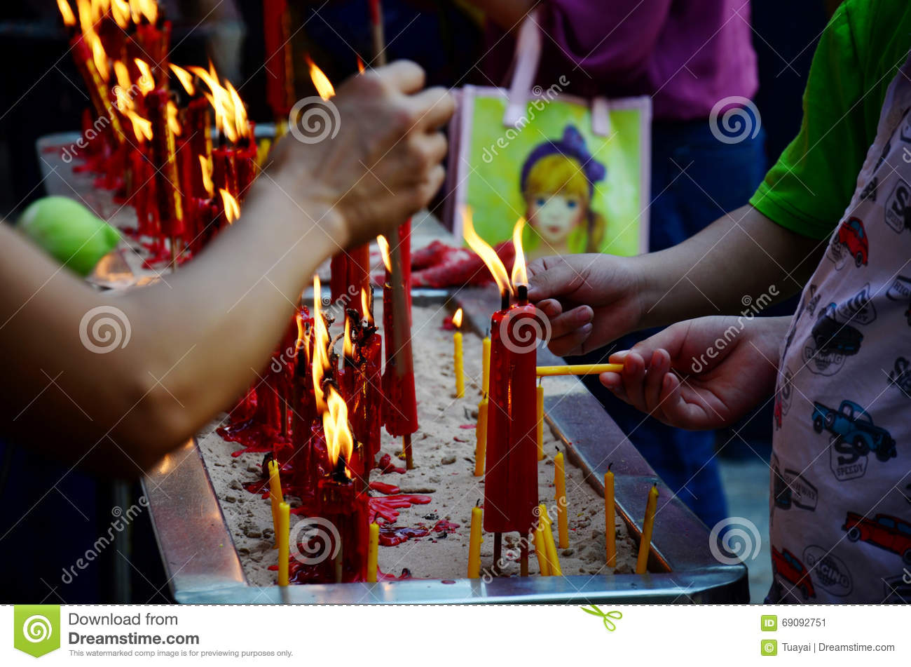 People Burning Incense And Red Candle For Pray God Stock