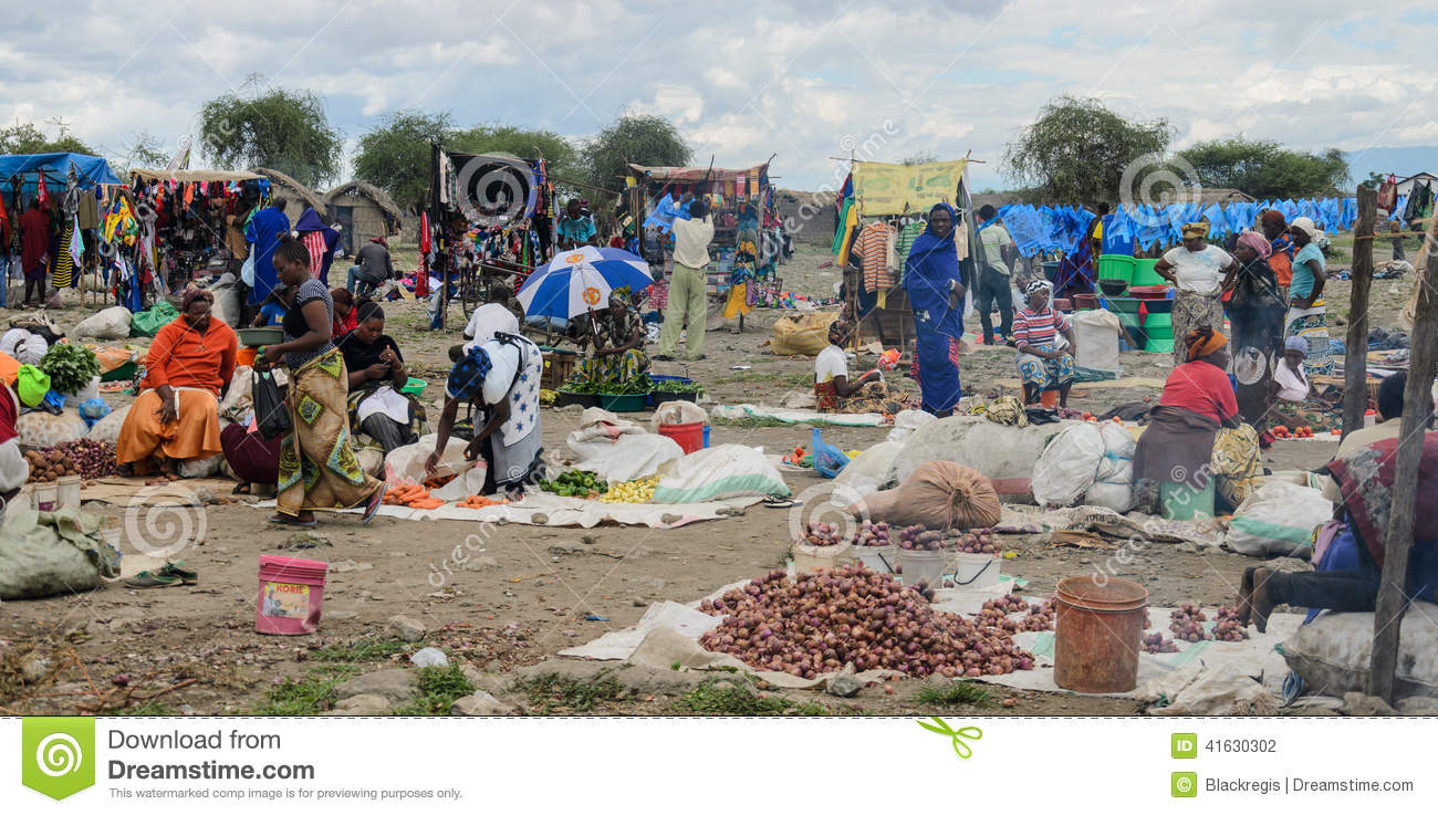 People buying products on the market on march in africa