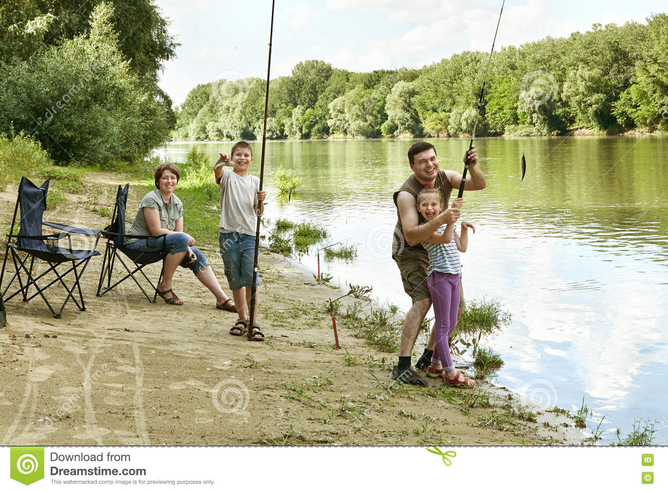 People camping and fishing family active in nature child for Campsites with fishing