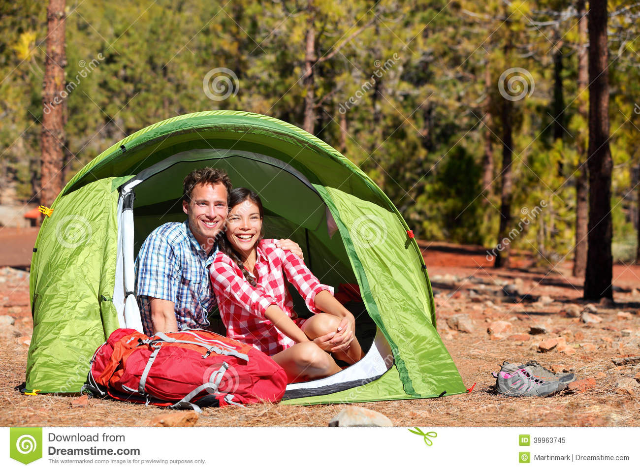 people camping in tent   happy backpacking couple stock