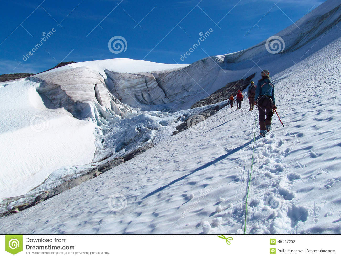 People climbers, climbing snow summit, rocky mountain peaks and glacier in Norway
