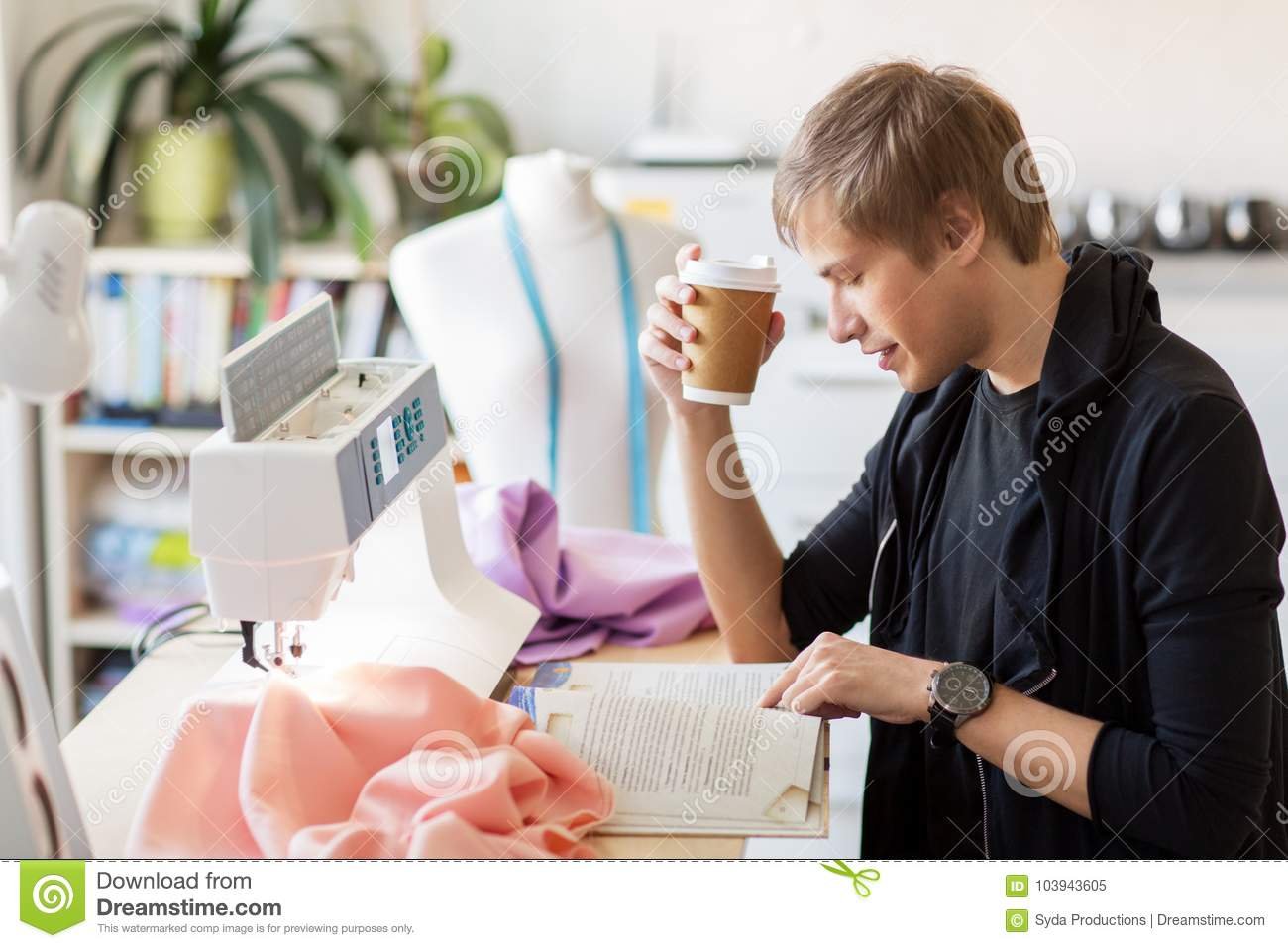 Fashion Designer With Coffee And Book At Studio Stock Image Image Of Male Drink 103943605