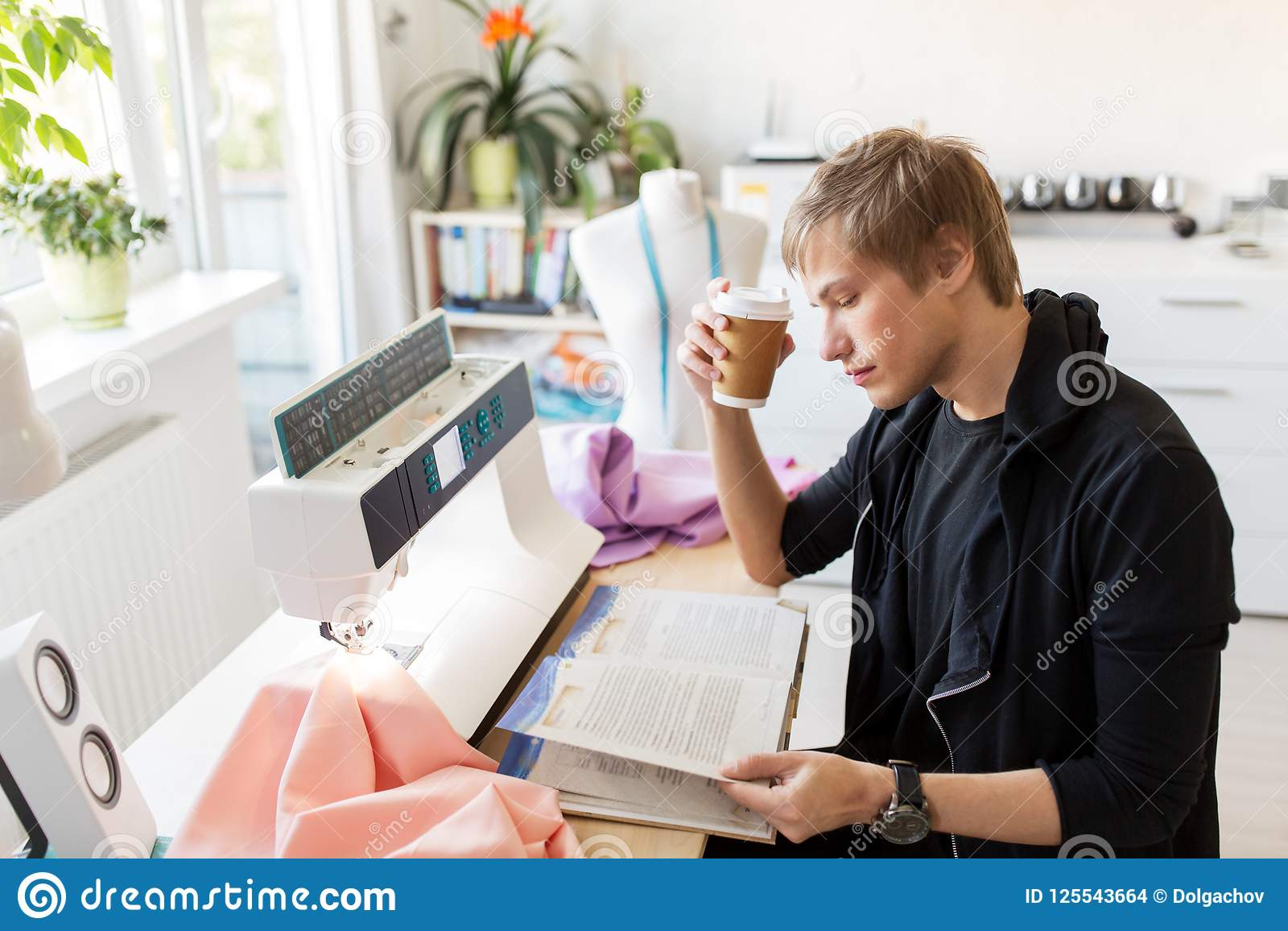 Fashion Designer With Coffee And Book At Studio Stock Photo Image Of Clothes Beverage 125543664