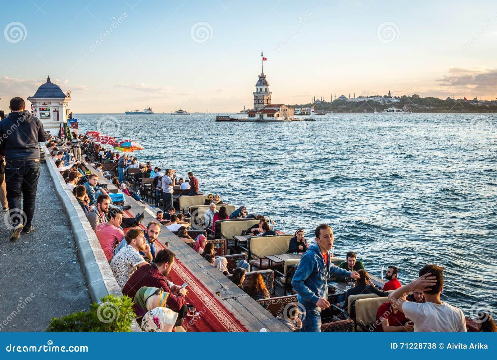 People on the coast of Bosphorus in Istanbul, Turkey