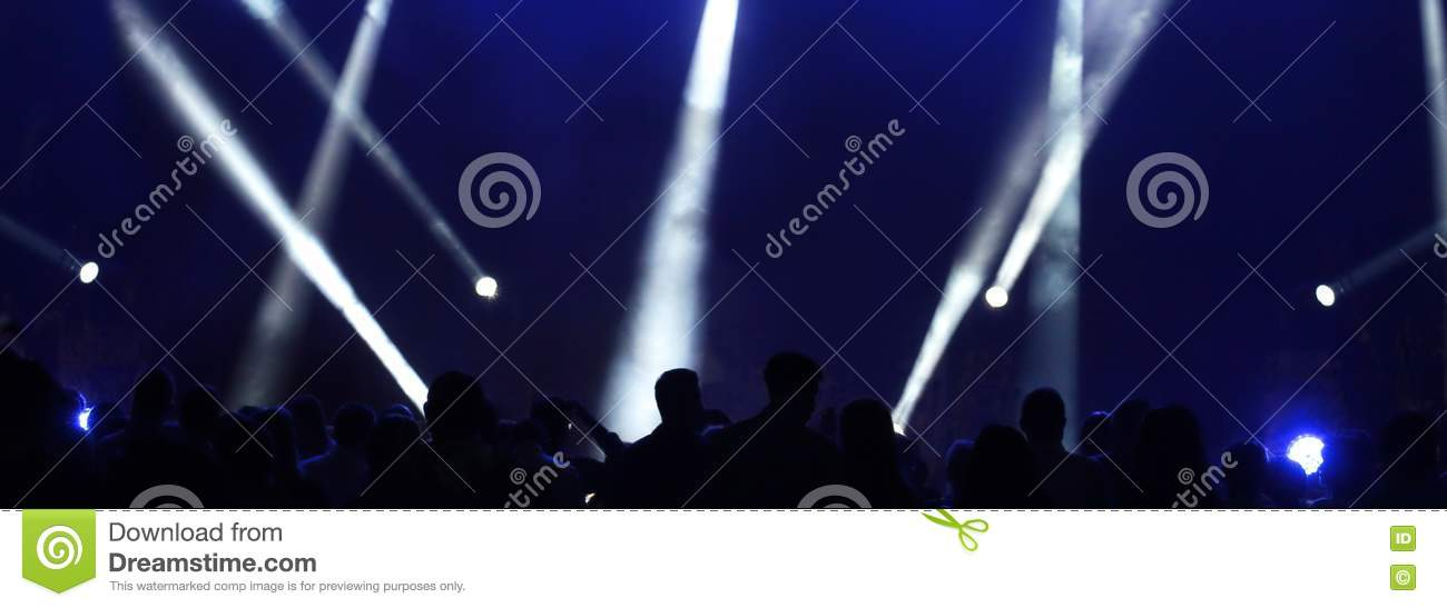 People at the concert and reflectors