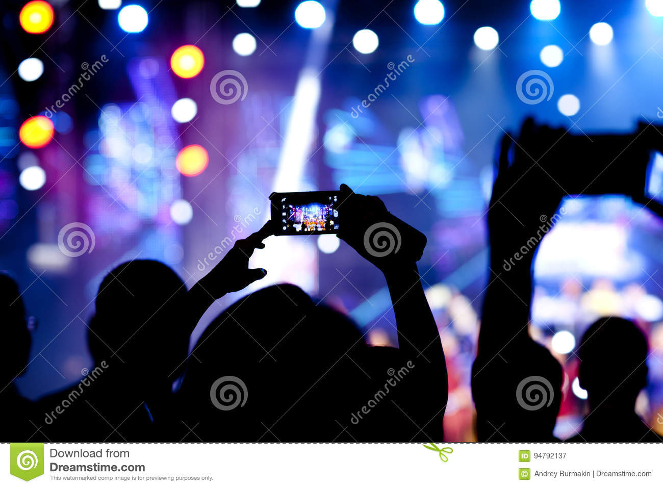 People at concert shooting video
