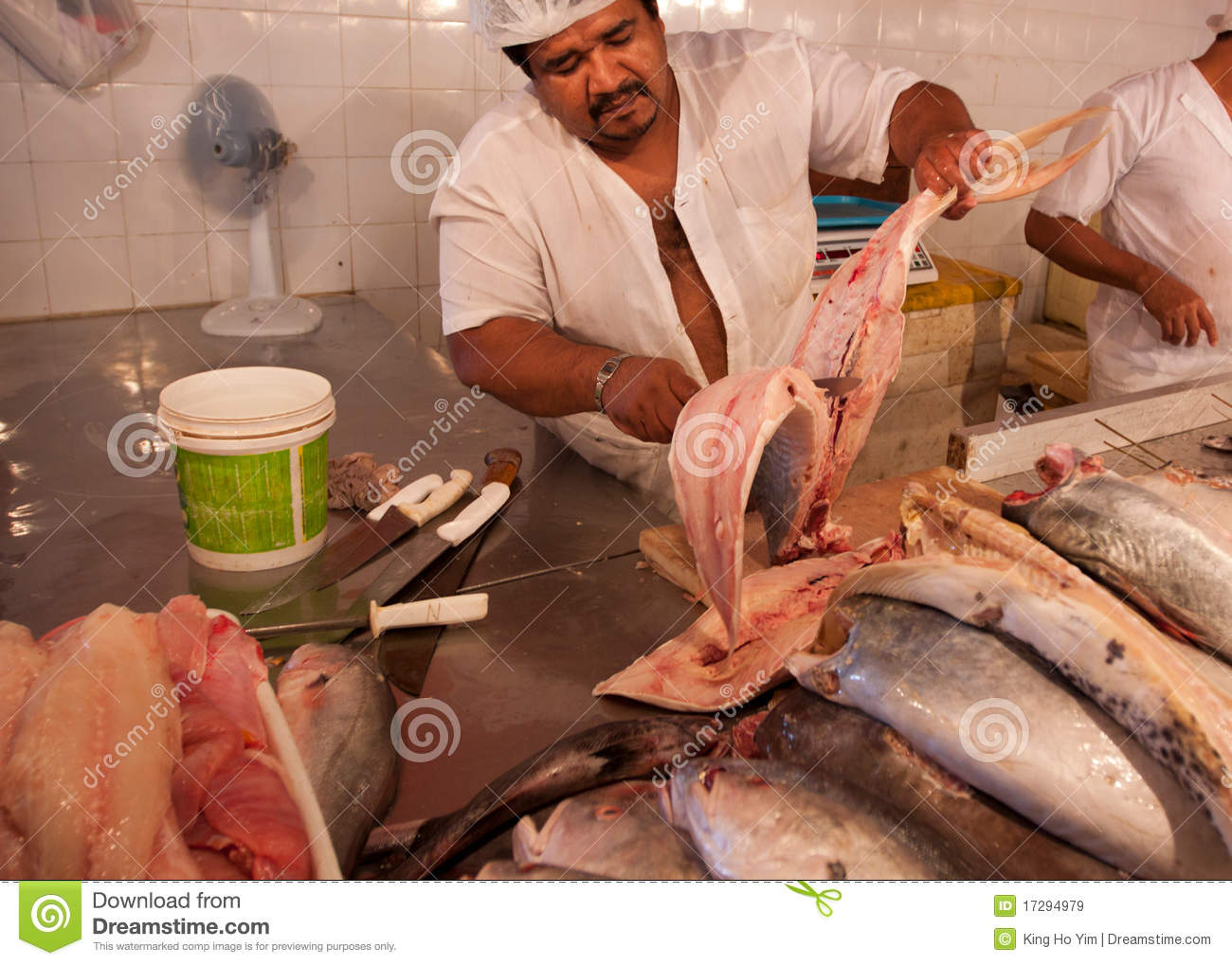 People cutting river fish in amazon editorial stock image for River fish market