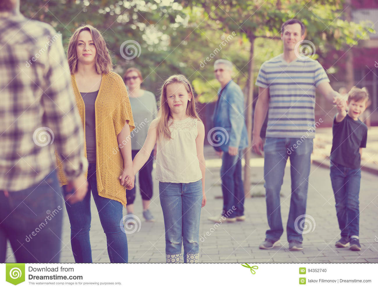 People of different ages walk in park