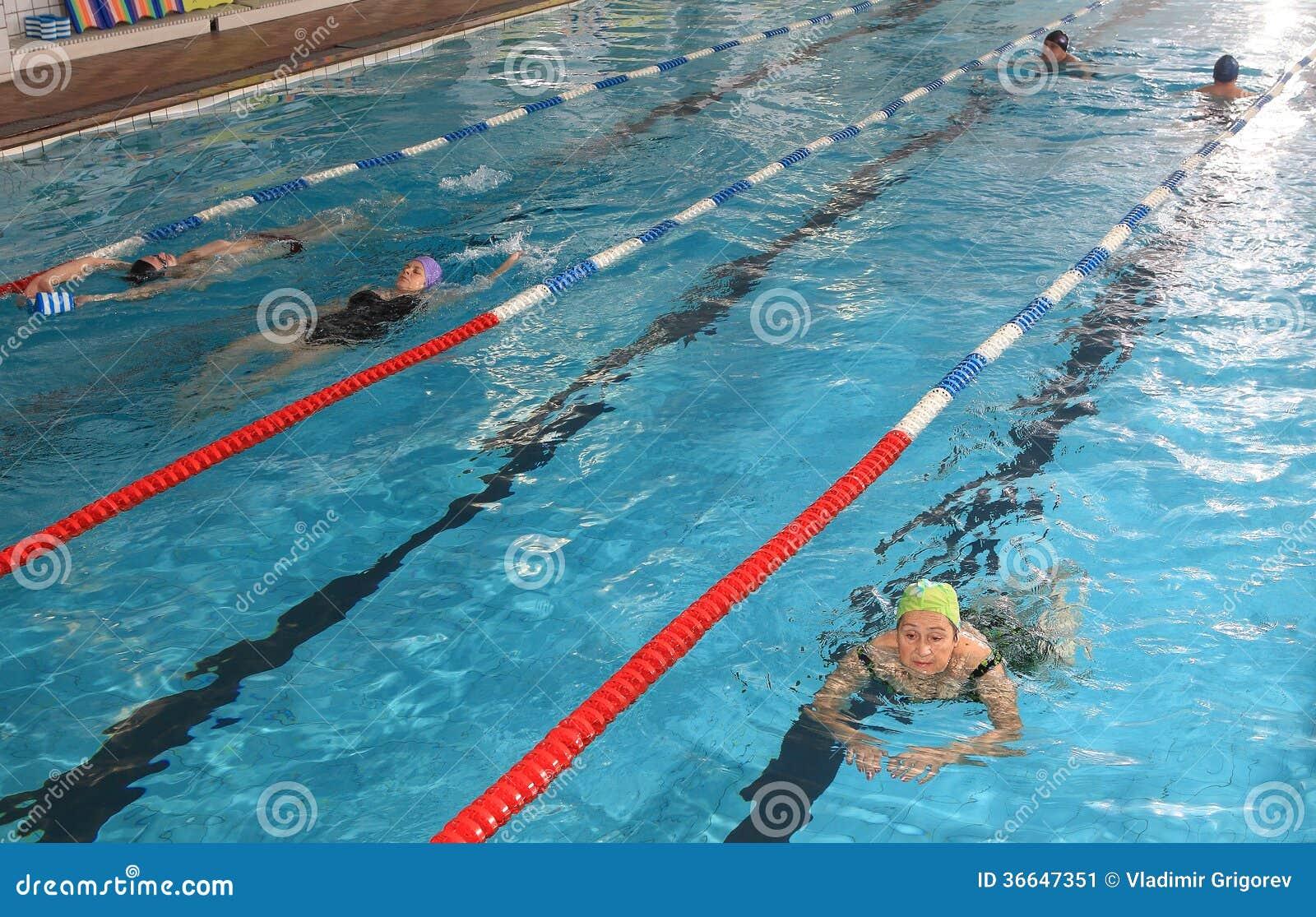 People swimming in public pool editorial image 44313620 for Alderwood pool public swim times