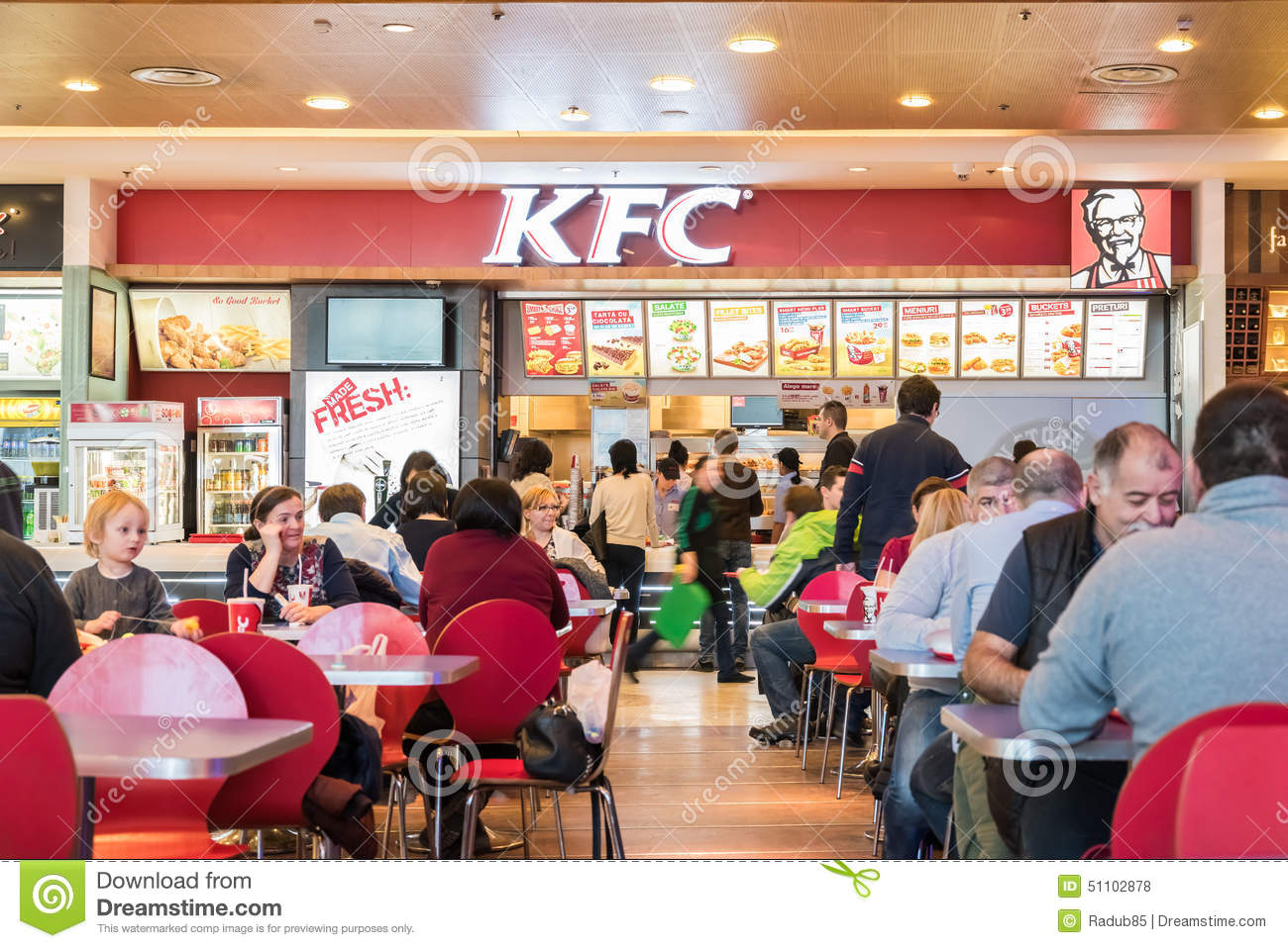People eating fast food from kfc restaurant editorial for Fast food restaurants open on easter