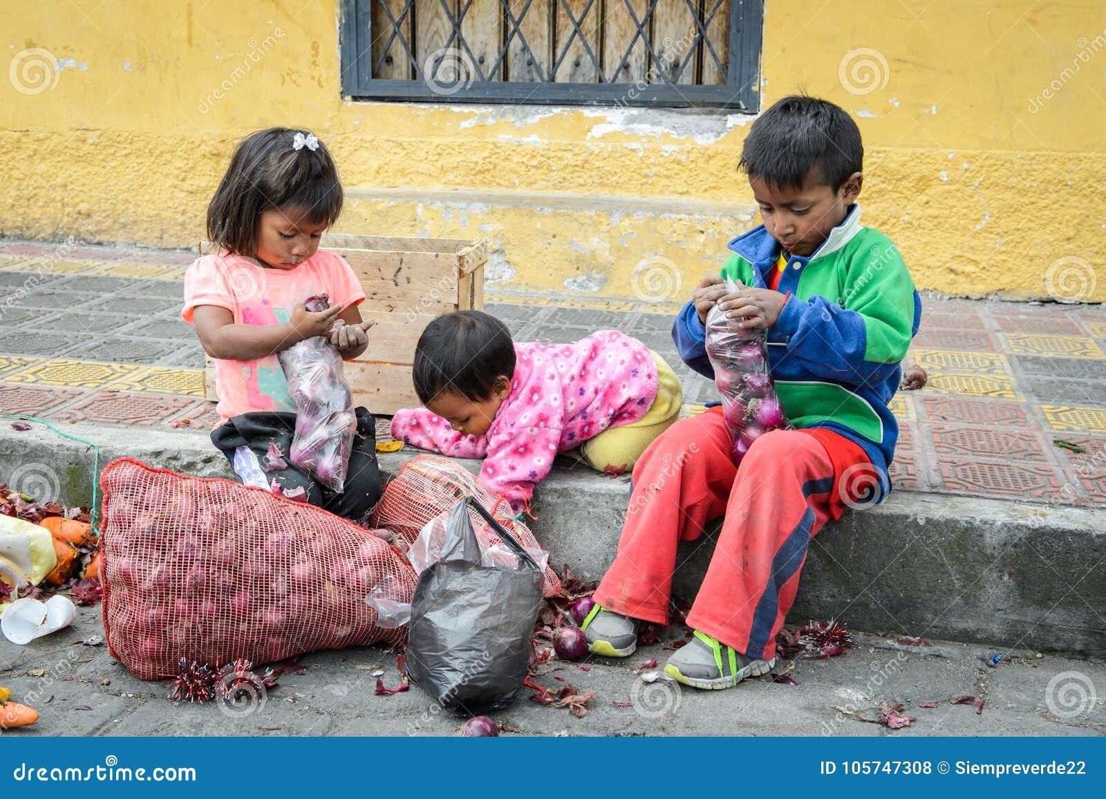Otavalo ecuador jan 3 2015 unidentified ecuadorian children with onion at the otavalo market 719 of ecuadorian people belong to the mestizo ethnic
