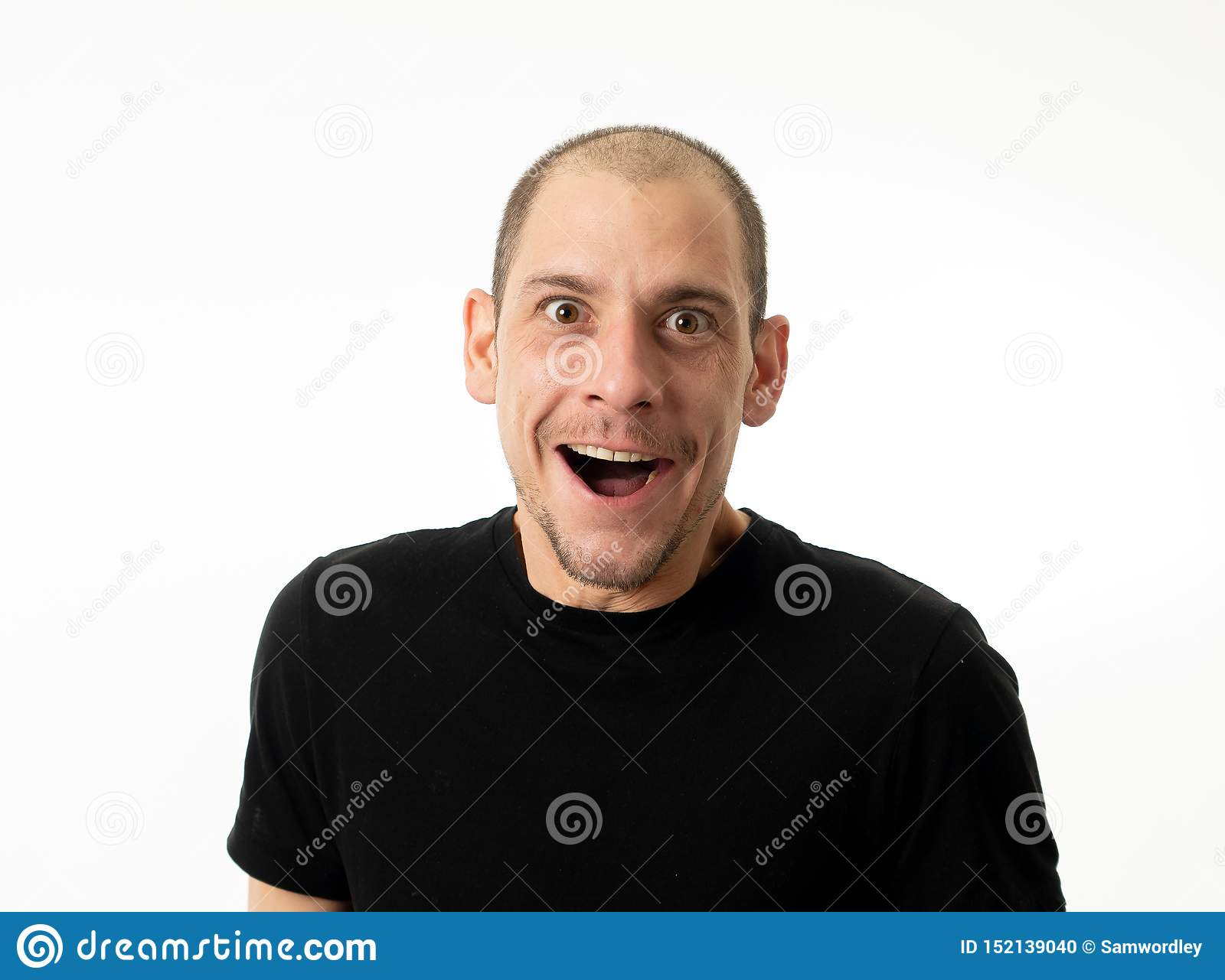 People emotions and facial expressions. Portrait of comic young man with funny crazy happy face