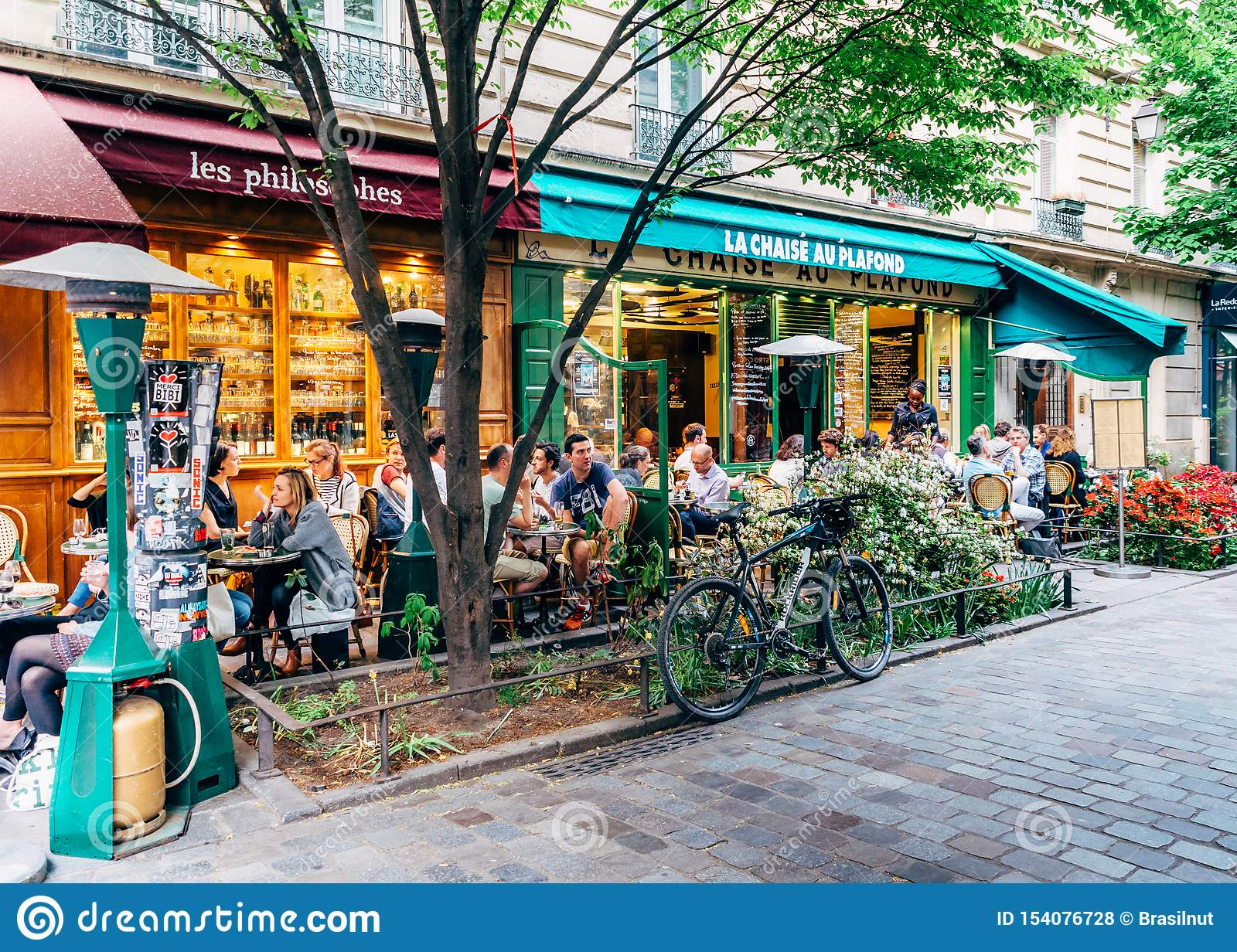 People Enjoy A Cafe And Conversation At A Quiet And Charming