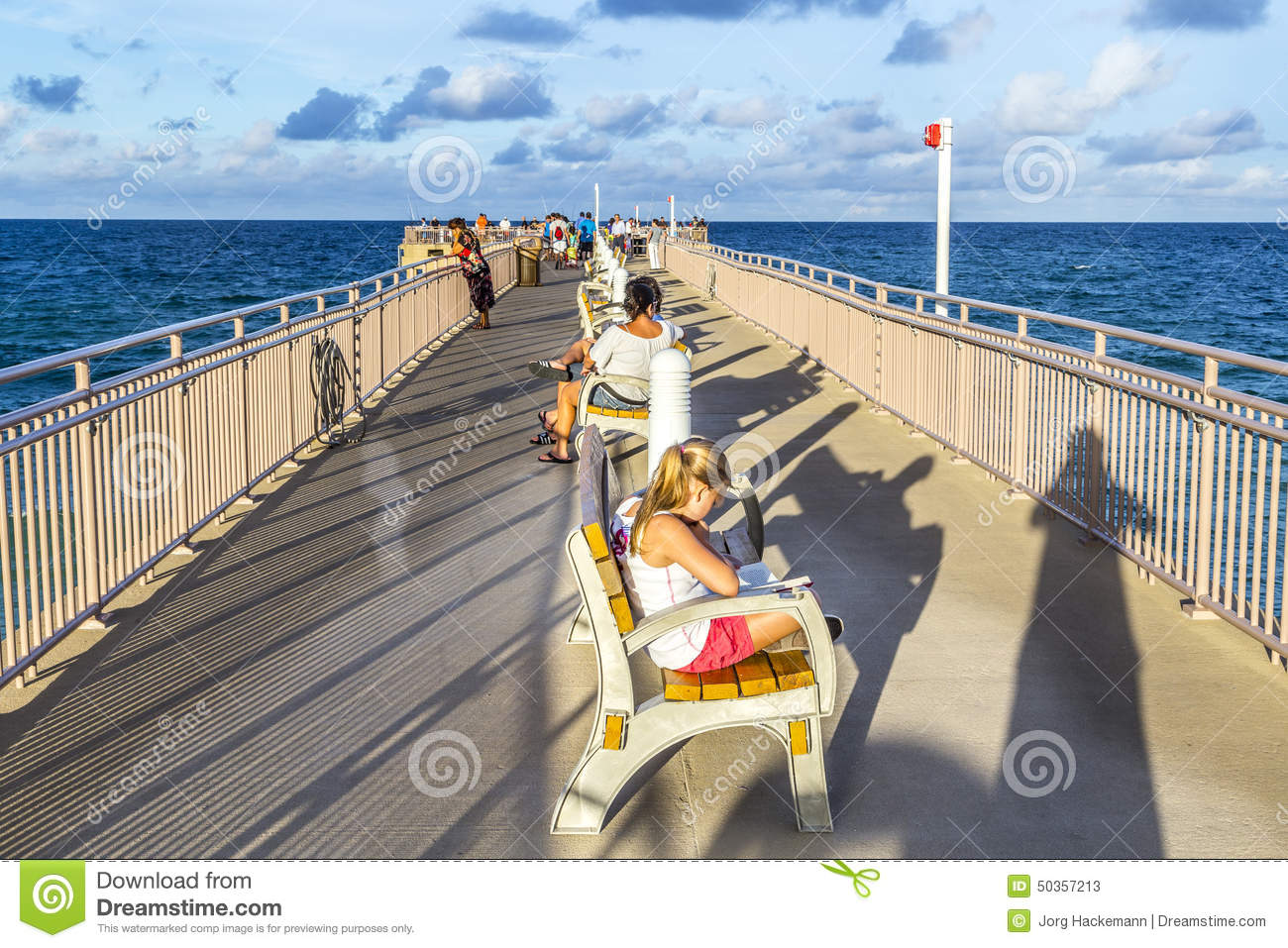 People enjoy the fishing pier in sunny isles beach for Fishing piers in florida