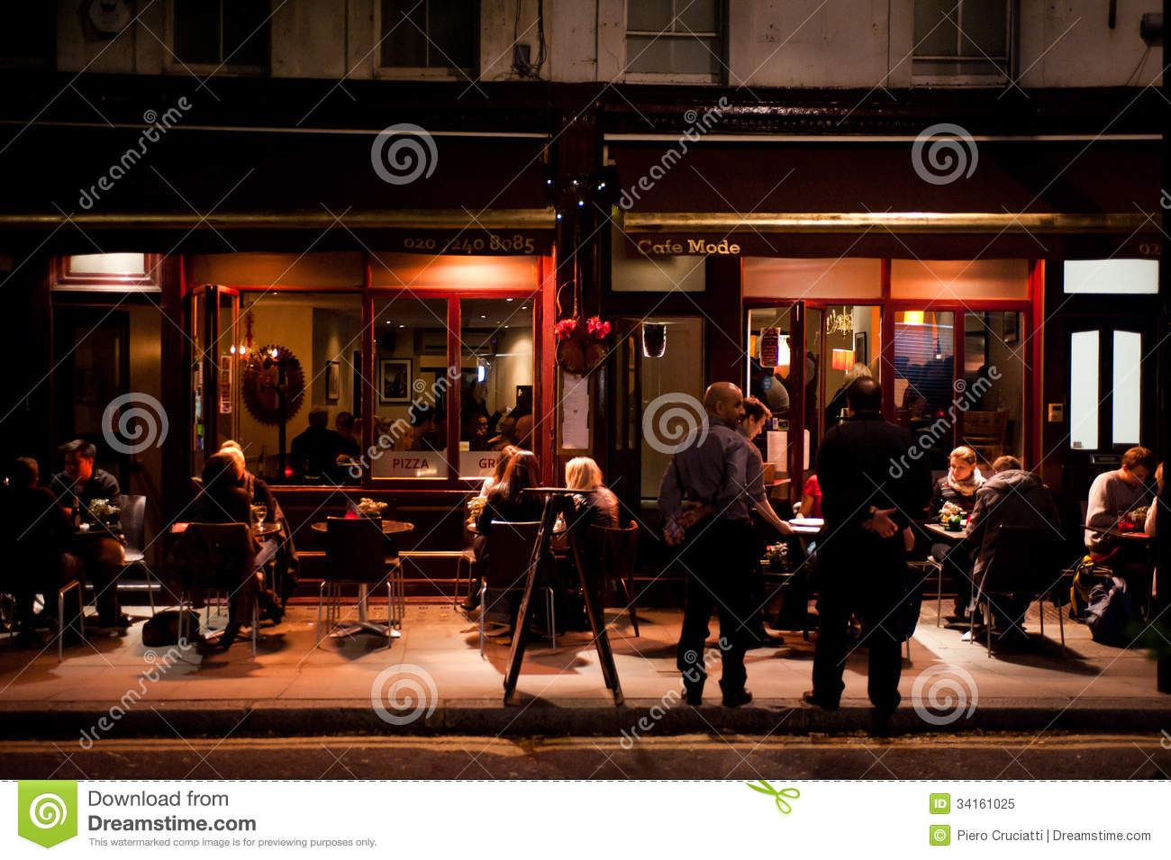people enjoy outdoor dining in london editorial image