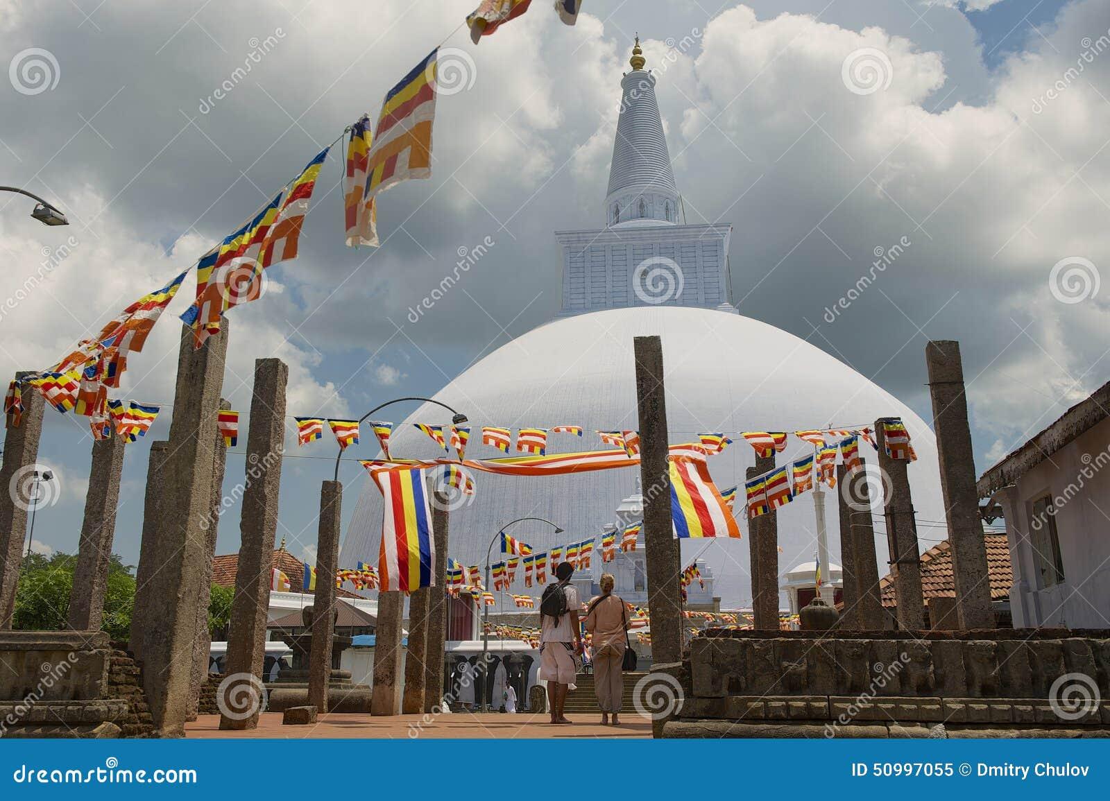 People enjoy the view to the Ruwanwelisaya stupa in Anuradhapura, Sri Lanka.