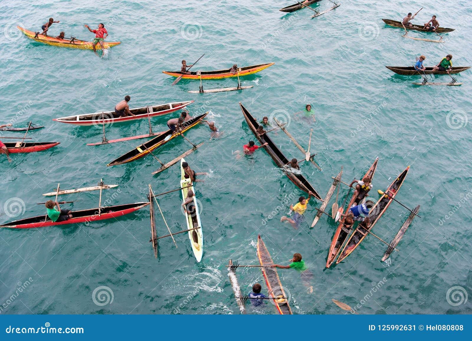 People enjoying rain in canoes on Pacific Ocean