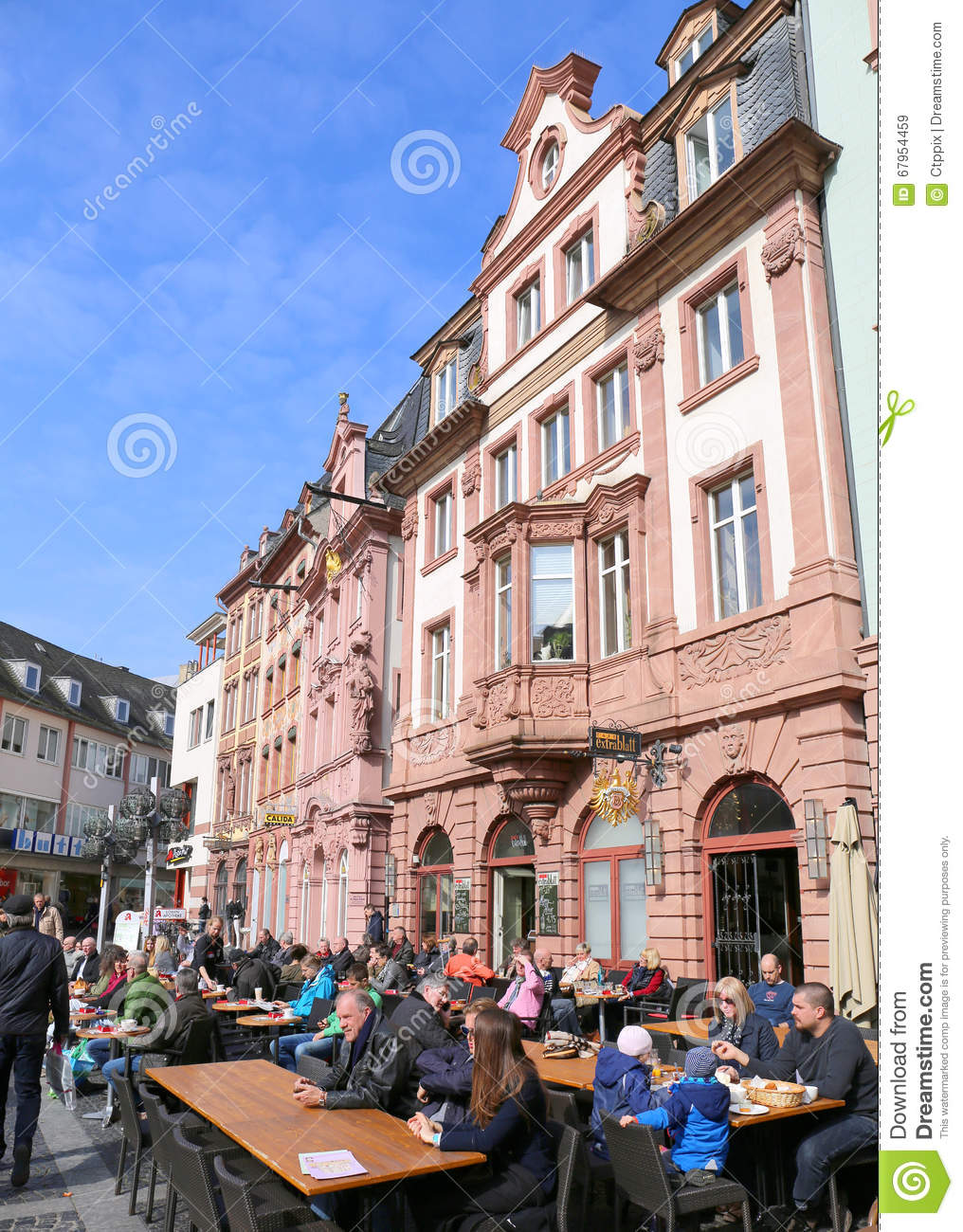 people enjoying sun and drinks outside the local cafe at the market place editorial stock image. Black Bedroom Furniture Sets. Home Design Ideas