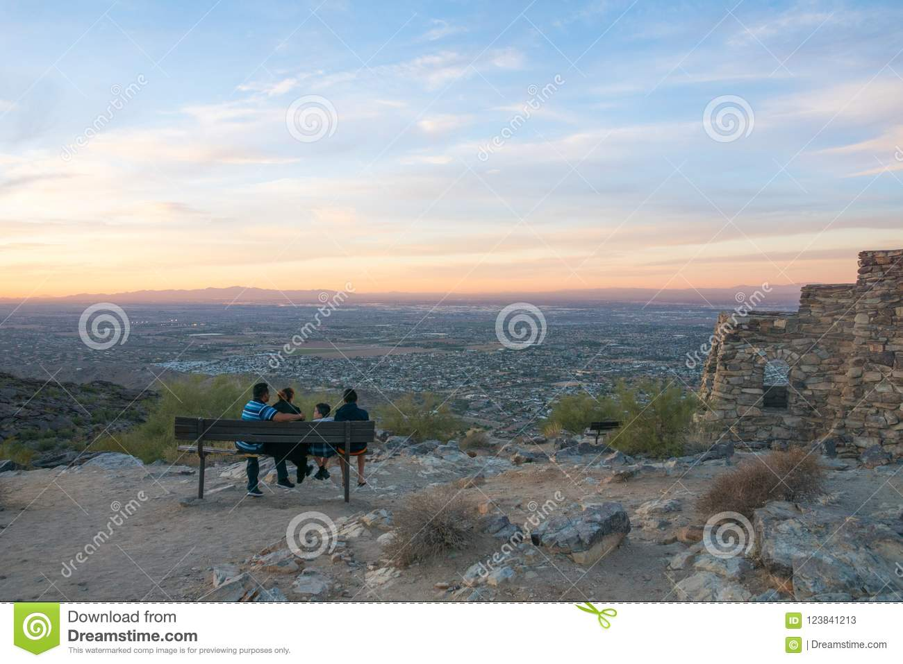 People enjoying the view over Arizona phoenix downtown from the mountains at sunset, usa, panorama
