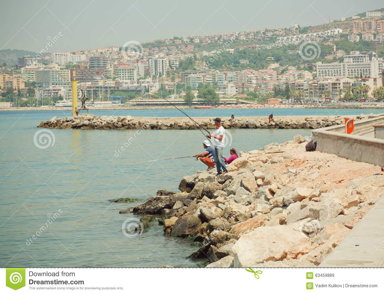People fishing on a bay of aegean sea at sunny day in for Videos of people fishing
