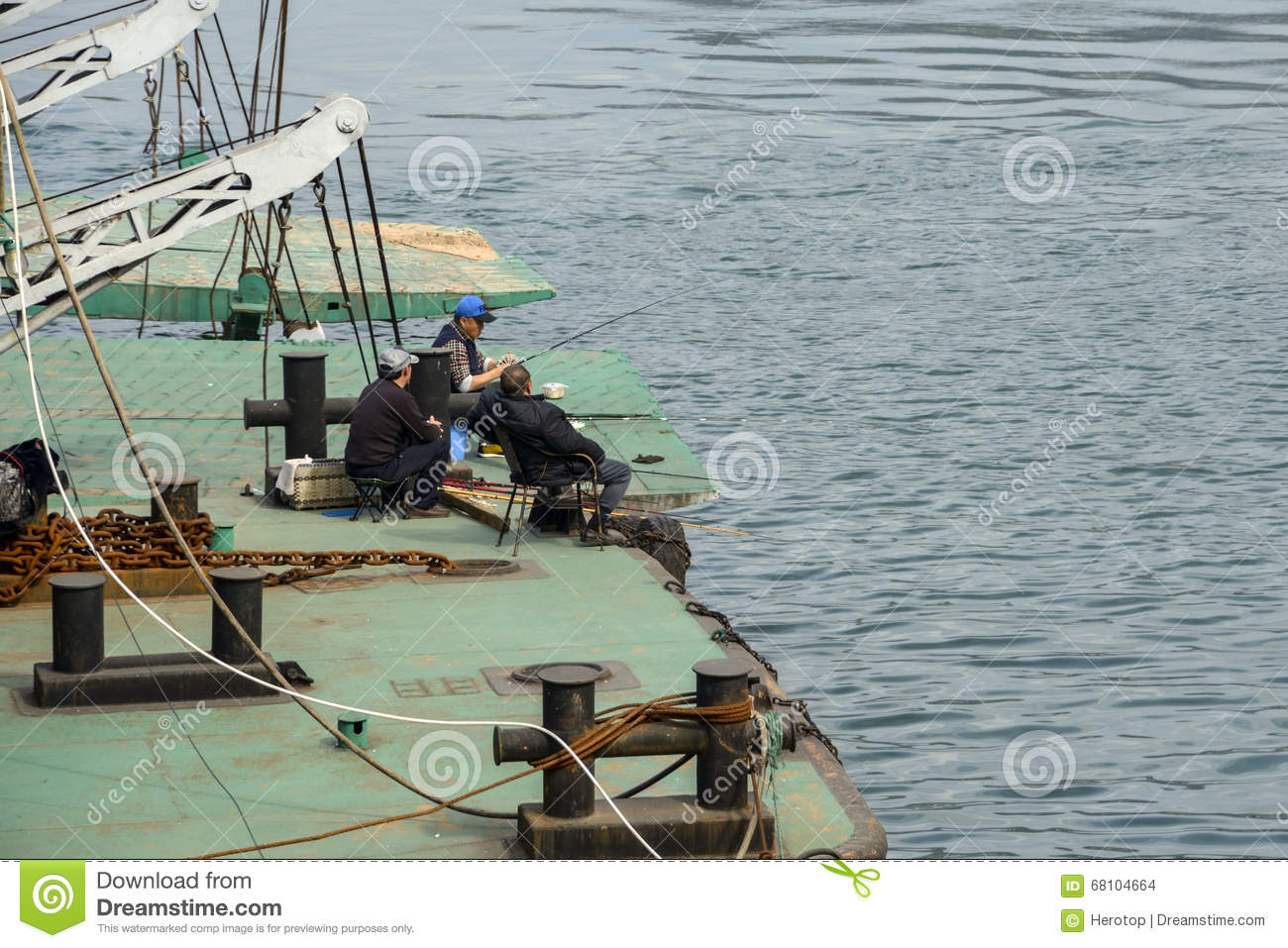 People fishing on the docks editorial stock image image for Videos of people fishing