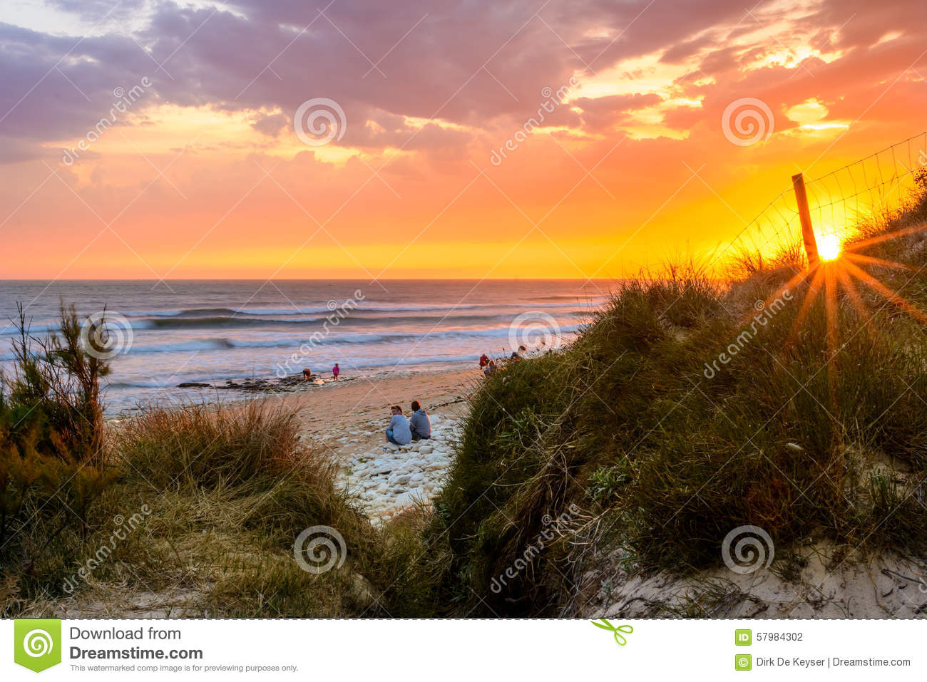 People on a French beach at sunset