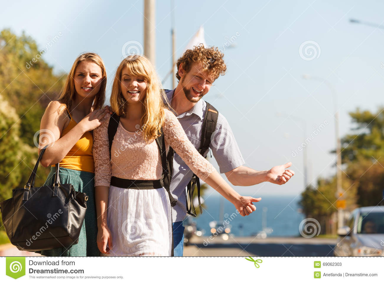 People friends hitchhiking on summer vacation.