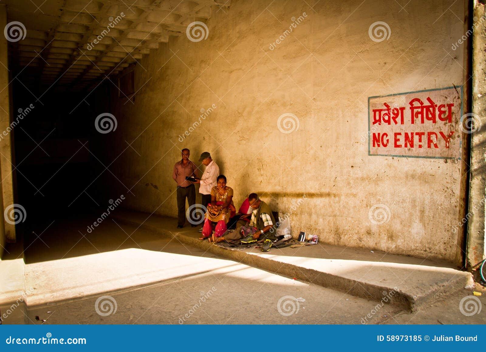 People in garage entrance kathmandu nepal editorial for Garage a persan