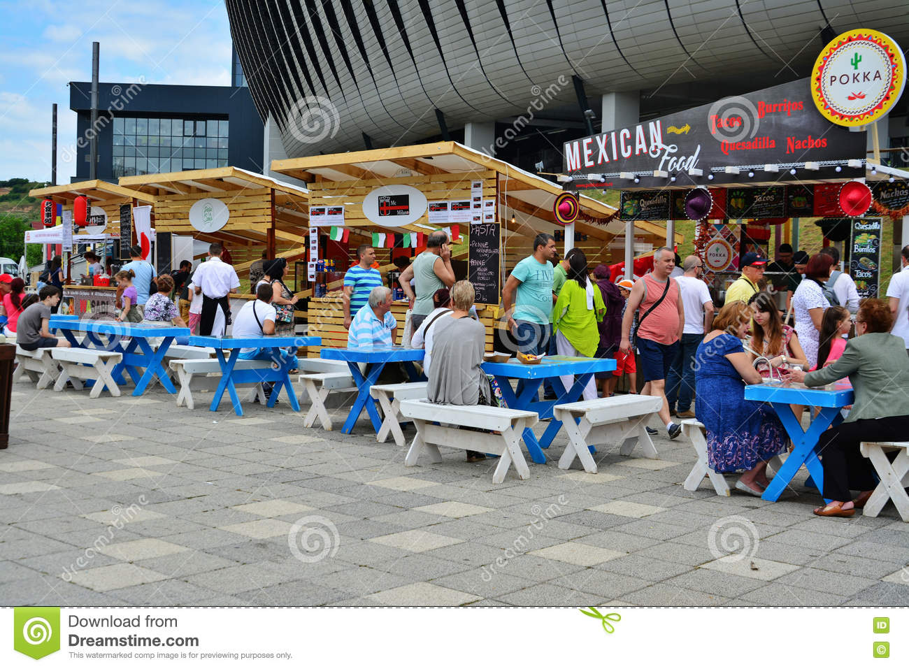 People Have A Snack At The Street Food Festival In Central Park Cluj